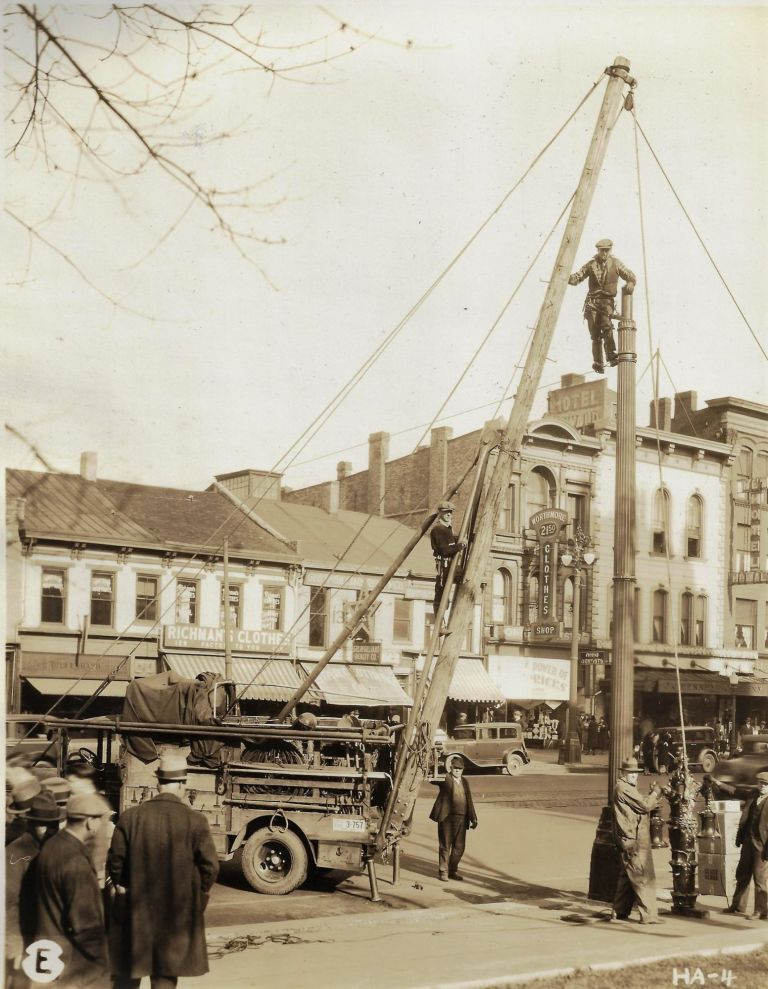 Album of Original Photographs Showing the Installation of Street Lights in Hamilton, Ohio, 1931. OHIO, ELECTRIC LIGHTING.