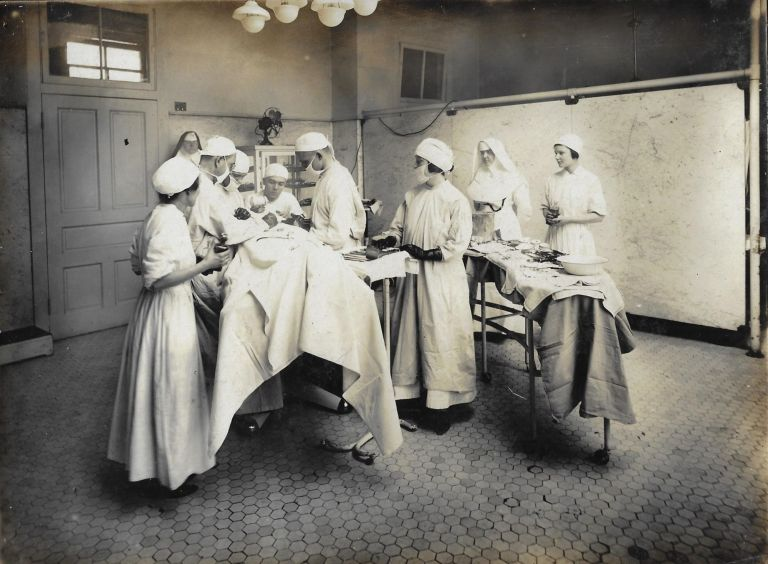 Photograph Album Documenting Nurses' Training at Mercy Hospital and College of Physicians & Surgeons, Baltimore, 1920. NURSING, BALTIMORE, SISTERS OF MERCY.
