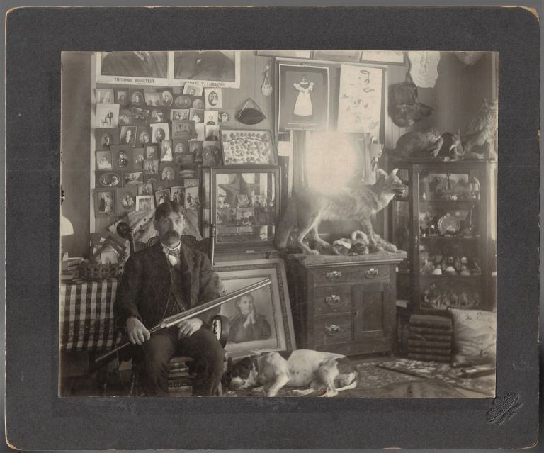"""""""The Collector"""" - Mounted Photograph of a Man Surrounded by His Many Collections. Frank E. Joerg."""