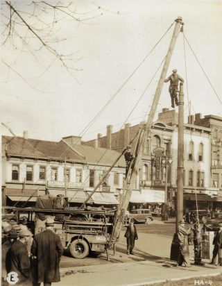 Album of Original Photographs Showing the Installation of Street Lights in Hamilton, Ohio, 1931....
